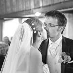 Fotograf-Charmed Wall-Kuss-Hochzeit